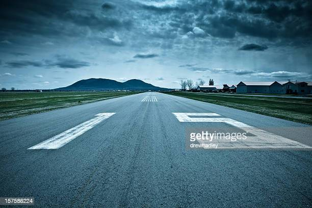 Landing strip, runway. Dramatic weather.