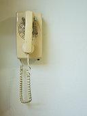 Landline home telephone hanging on wall