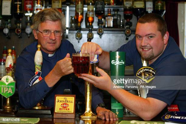 Landlord Lee Goodship of the Catherine Wheel Public House in Gravesend Hertfordshire swaps jobs with Rev Tony Raven to raise funds for the local...