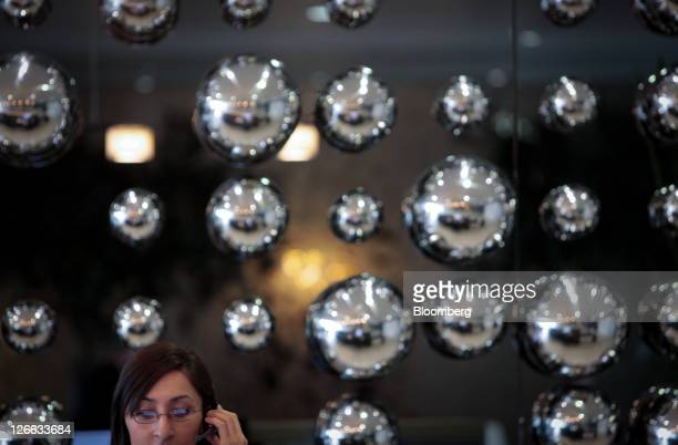 A Landmark Plc employee speaks on a telephone at the company's headquarters inside the Heron Tower in London UK on Monday Sept 26 2011 UK commercial...