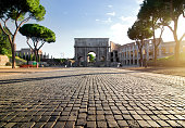 Arc of Constantin and Colosseum in Rome at sunrise, Italy