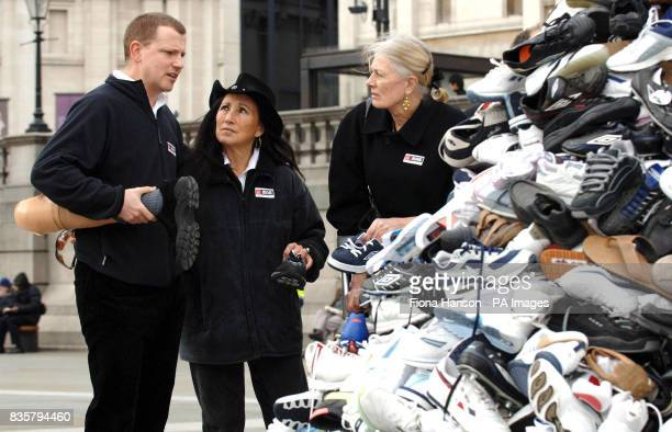 Landmine survivor and BBC journalist Stuart Hughes with his prosthetic leg talking with protest singer Julie Felix and actress Vanessa Redgrave by a...