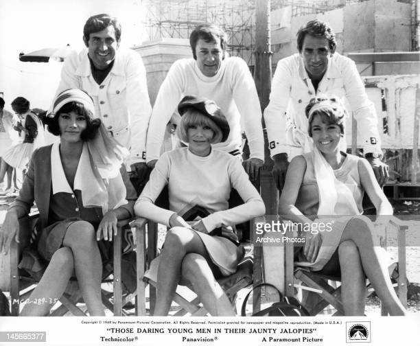 Lando Buzzanca Mireille Darc Tony Curtis Walter Chiari and actresses posing for picture offcamera from the film 'Those Daring Young Men In Their...