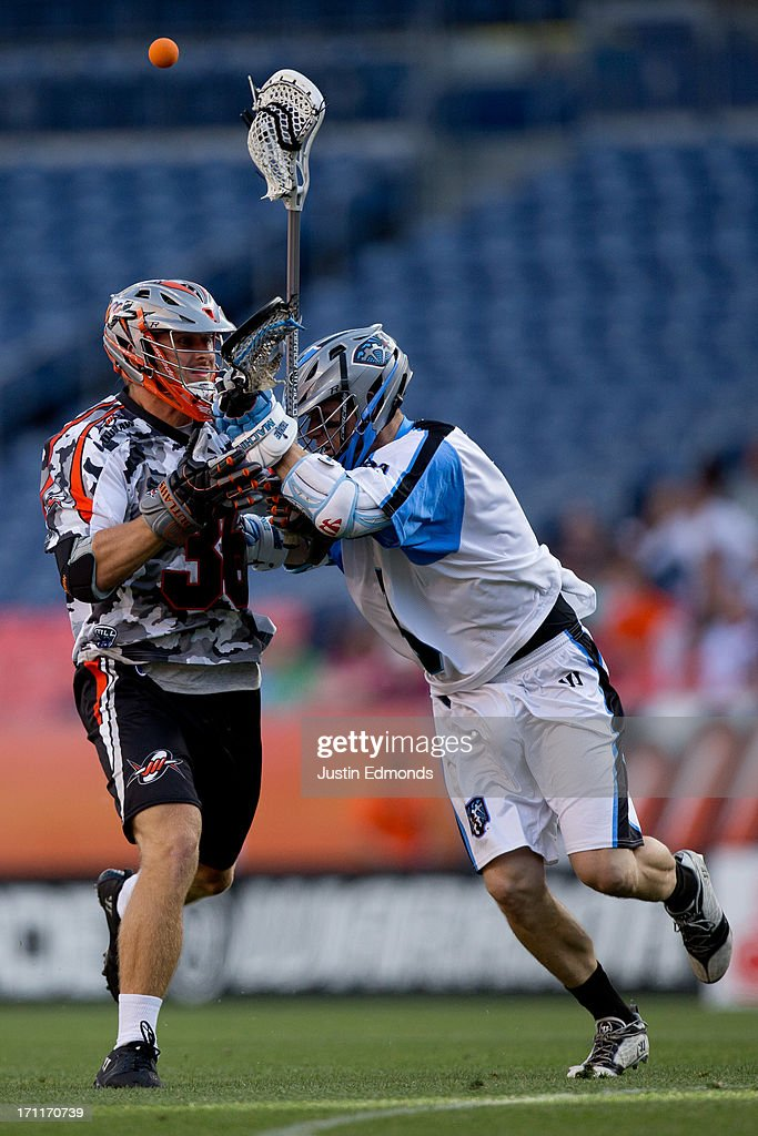 Landon Carr #36 of the Denver Outlaws loses control of the ball after getting checked by Brett Garber #3 of the Ohio Machine during the first quarter at Sports Authority Field at Mile High on June 22, 2013 in Denver, Colorado.