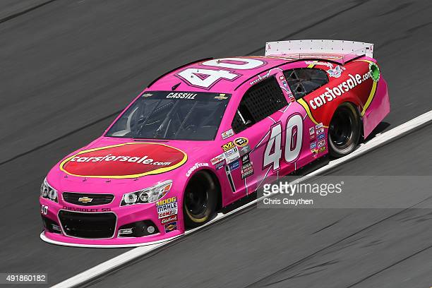 Landon Cassill driver of the Carsforsalecom Chevrolet practices for the NASCAR Sprint Cup Series Bank of America 500 at Charlotte Motor Speedway on...