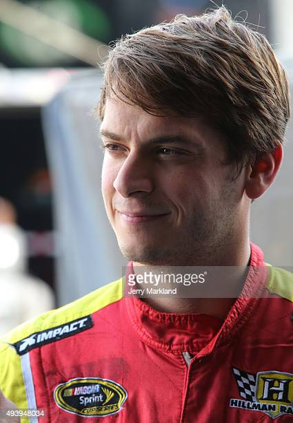 Landon Cassill driver of the Carsforsalecom Chevrolet stands in the garage area during practice for the NASCAR Sprint Cup Series CampingWorldcom 500...