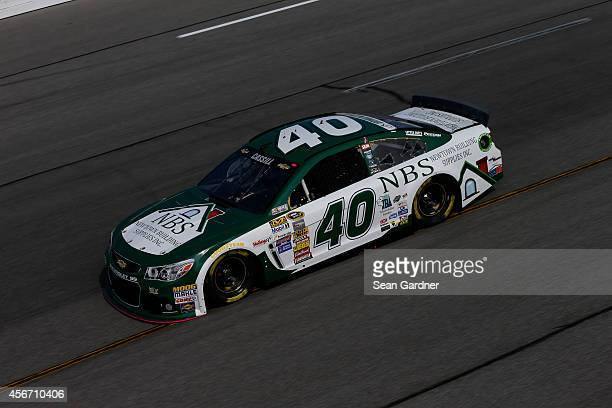 Landon Cassill driver of the Chevrolet drives during practice for the NASCAR Sprint Cup Series Federated Auto Parts 400 at Richmond International...