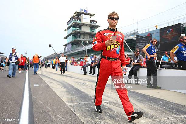 Landon Cassill driver of the Chevrolet walks down pit road during qualifying for the NASCAR Sprint Cup Series Crown Royal Presents the Jeff Kyle 400...