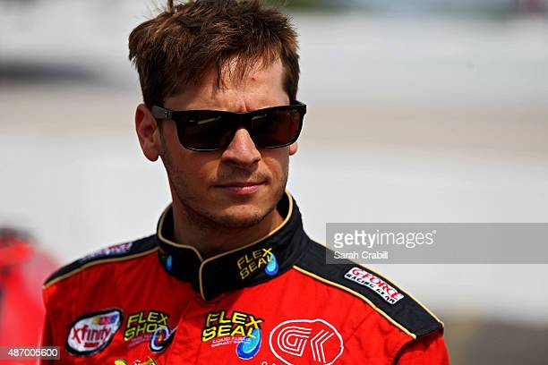 Landon Cassill driver of the Flex Seal Chevrolet looks on from the grid during qualifying for the NASCAR XFINITY Series VFW Sport Clips Help A Hero...
