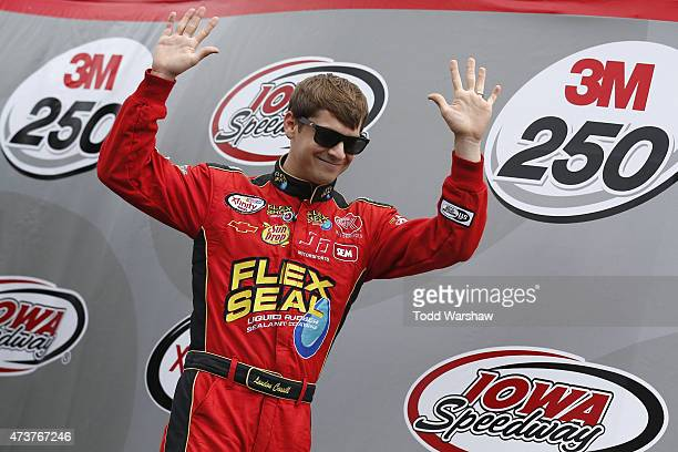 Landon Cassill driver of the Flex Seal Chevrolet waves to fans before the NASCAR XFinity Series 3M 250 at Iowa Speedway on May 16 2015 in Newton Iowa