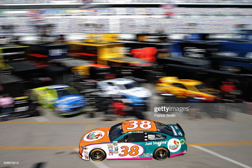 Landon Cassill, driver of the #38 Florida Lottery Ford, drives through the garage area during practice for the NASCAR Sprint Cup Series Daytona 500 at Daytona International Speedway on February 13, 2016 in Daytona Beach, Florida.