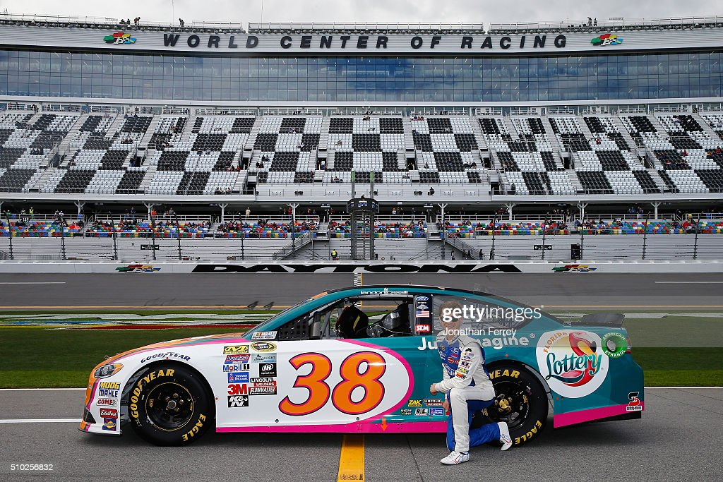 <a gi-track='captionPersonalityLinkClicked' href=/galleries/search?phrase=Landon+Cassill&family=editorial&specificpeople=4421398 ng-click='$event.stopPropagation()'>Landon Cassill</a>, driver of the #38 Florida Lottery Ford, poses with his car after qualifying for the NASCAR Sprint Cup Series Daytona 500 at Daytona International Speedway on February 14, 2016 in Daytona Beach, Florida.
