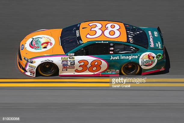 Landon Cassill driver of the Florida Lottery Ford practices for the NASCAR Sprint Cup Series Daytona 500 at Daytona International Speedway on...