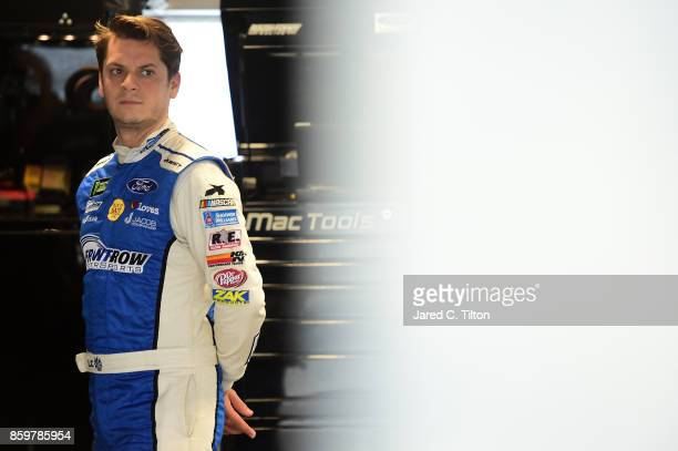 Landon Cassill driver of the Ford Performance Ford stands in the garage area during testing for the Monster Energy NASCAR Cup Series at Martinsville...