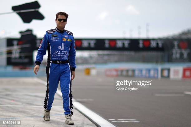 Landon Cassill driver of the Jacob Companies Ford stands on the grid during qualifying for the Monster Energy NASCAR Cup Series I Love NY 355 at The...