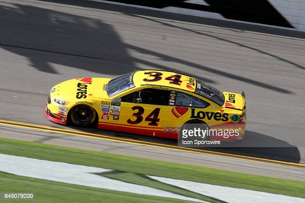 Landon Cassill driver of the Love's Travel Stops Ford during practice for the NASCAR Monster Energy Cup Series Daytona 500 on February 24 at the...