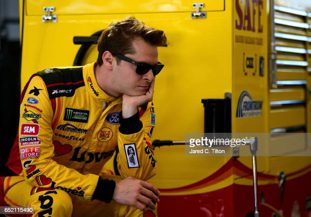 Landon Cassill driver of the Love's Travel Stops Ford looks on during practice for the Monster Energy NASCAR Cup Series Kobalt 400 at Las Vegas Motor...