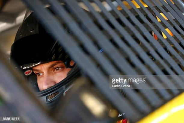 Landon Cassill driver of the Love's Travel Stops Ford looks on during practice for the Monster Energy NASCAR Cup Series O'Reilly Auto Parts 500 at...