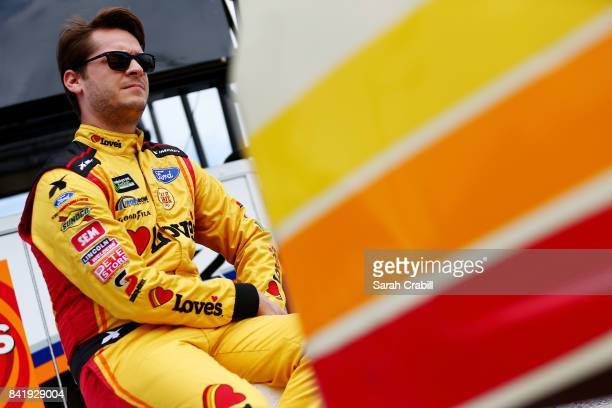 Landon Cassill driver of the Loves Travel Stops Ford looks on from the grid during qualifying for the Monster Energy NASCAR Cup Series Bojangles'...