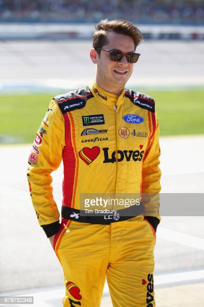 Landon Cassill driver of the Love's Travel Stops Ford stands on the grid during qualifying for the Monster Energy NASCAR Cup Series GEICO 500 at...