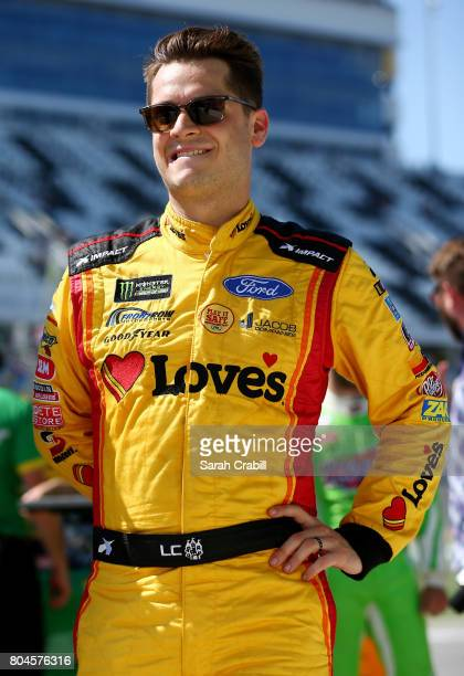 Landon Cassill driver of the Love's Travel Stops Honoring the Quiet Professional Ford stands on the grid during qualifying for the Monster Energy...