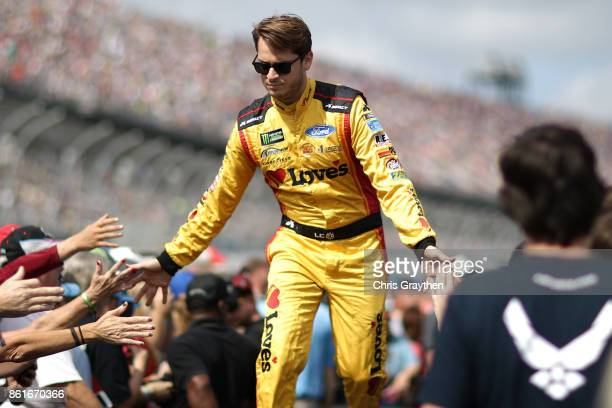 Landon Cassill driver of the Love's Travel Stops/CSX Play It Safe Ford is introduced prior to the Monster Energy NASCAR Cup Series Alabama 500 at...
