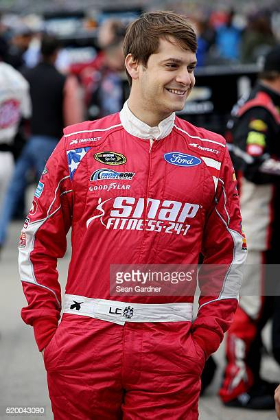 Landon Cassill driver of the MDS Transport Ford stands on the grid prior to the NASCAR Sprint Cup Series Duck Commander 500 at Texas Motor Speedway...