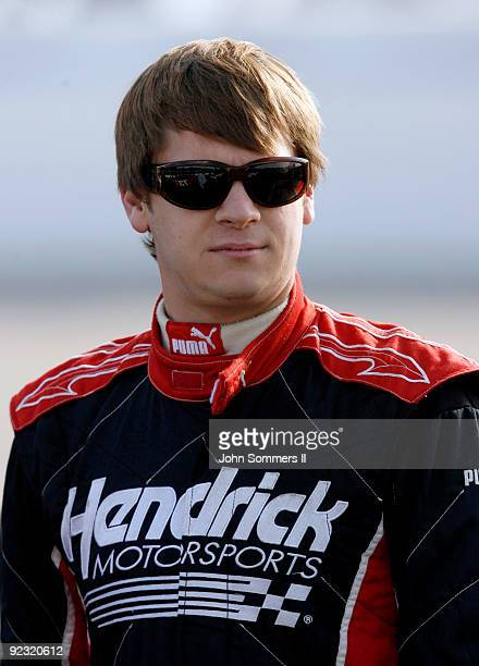 Landon Cassill driver of the Miccosukee Indiana Gaming Resort Chevrolet stands on the grid during qualifying for the NASCAR Nationwide series Kroger...