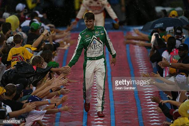 Landon Cassill driver of the Newtown Building Supplies Chevrolet greets fans during the NASCAR Sprint Cup Series Coke Zero 400 at Daytona...