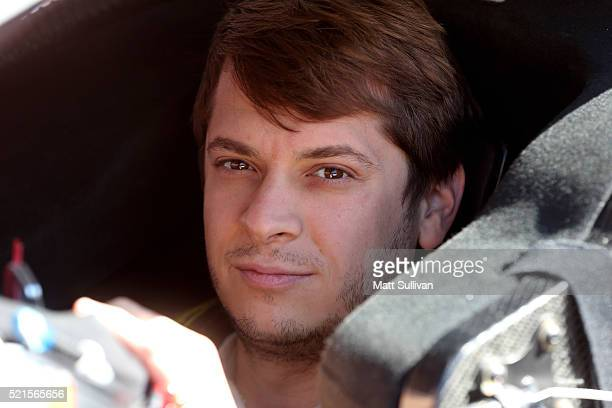 Landon Cassill driver of the Snap Fitness Ford sits in his car during practice for the NASCAR Sprint Cup Series Food City 500 at Bristol Motor...