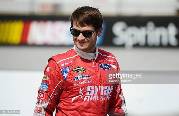 Landon Cassill driver of the Snap Fitness Ford stands on the grid during qualifying for the NASCAR Sprint Cup Series Food City 500 at Bristol Motor...