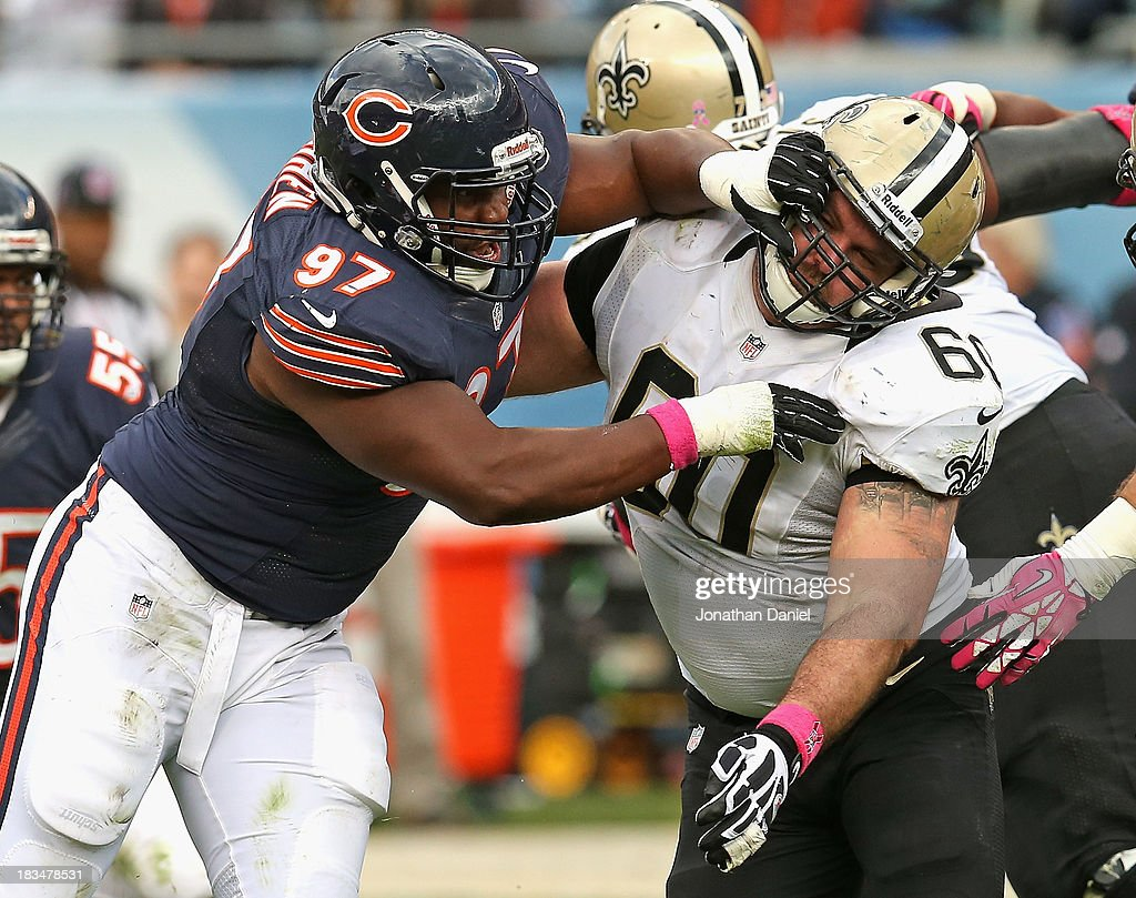 <a gi-track='captionPersonalityLinkClicked' href=/galleries/search?phrase=Landon+Cohen&family=editorial&specificpeople=5313982 ng-click='$event.stopPropagation()'>Landon Cohen</a> #97 of the Chicago Bears rushes against Brian de la Puente #60 of the New Orleans Saints at Soldier Field on October 6, 2013 in Chicago, Illinois. The Saints defeated the Bears 26-18.