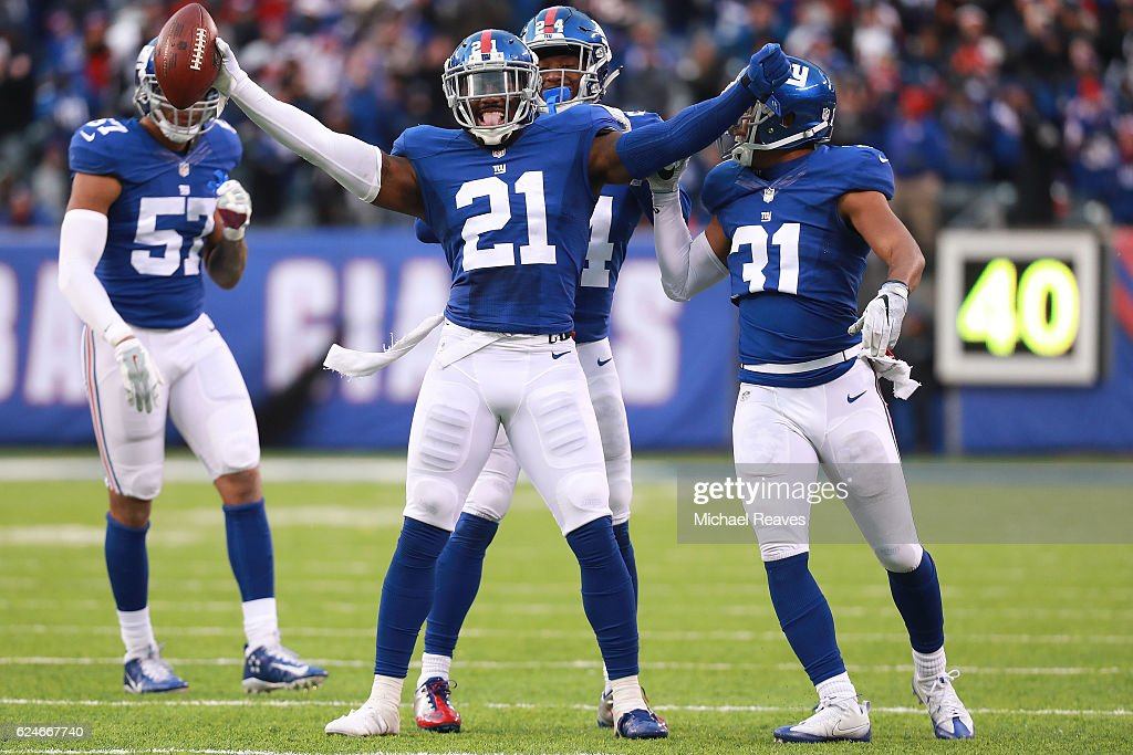 Landon Collins #21 of the New York Giants celebrates with teammates after an interception in the final minutes as they defeated the Chicago Bears 22-16 at MetLife Stadium on November 20, 2016 in East Rutherford, New Jersey.