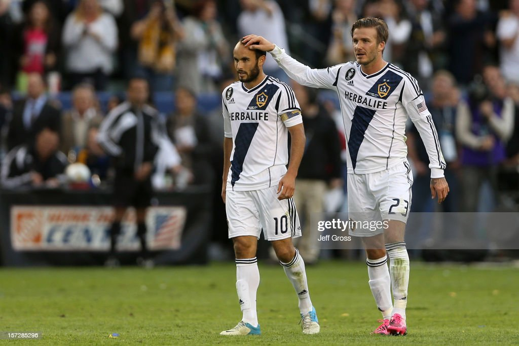 Landon Donovan #10 and David Beckham #23 of Los Angeles Galaxy celebrate in the second half against the Houston Dynamo in the 2012 MLS Cup at The Home Depot Center on December 1, 2012 in Carson, California.