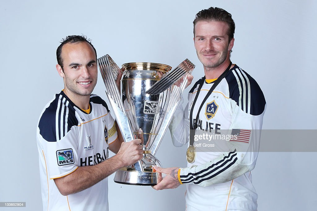 <a gi-track='captionPersonalityLinkClicked' href=/galleries/search?phrase=Landon+Donovan&family=editorial&specificpeople=171601 ng-click='$event.stopPropagation()'>Landon Donovan</a> #10 and <a gi-track='captionPersonalityLinkClicked' href=/galleries/search?phrase=David+Beckham&family=editorial&specificpeople=158480 ng-click='$event.stopPropagation()'>David Beckham</a> #23 of the Los Angeles Galaxy pose for a portrait following the 2011 MLS Cup at The Home Depot Center on November 20, 2011 in Carson, California.
