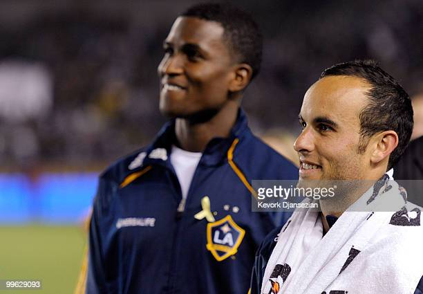Landon Donovan and Edson Buddle of the Los Angeles Galaxy look at the stadium screen during a World Cup send off ceremony for them after the MLS...