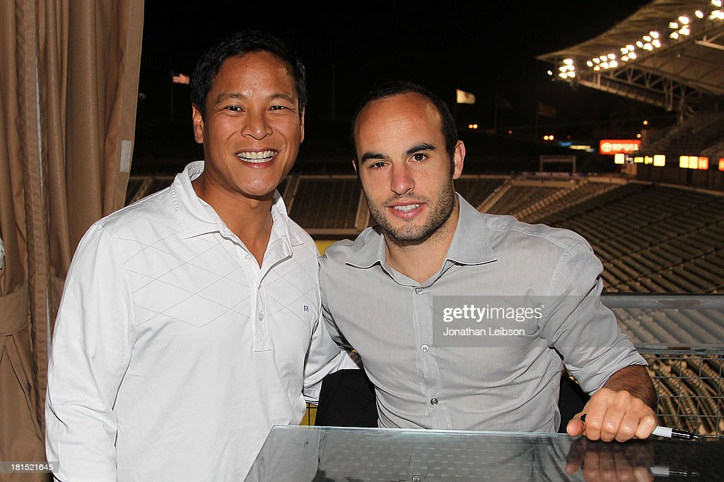 Landon Donovan (R) and Guests attend the American Express VIP Game Experience With Landon Donovan at StubHub Center on September 21, 2013 in Los Angeles, California.