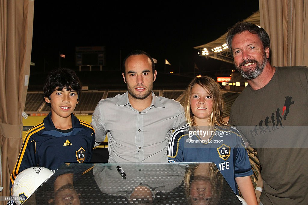 Landon Donovan (C) and guests attend the American Express VIP Game Experience With Landon Donovan at StubHub Center on September 21, 2013 in Los Angeles, California.