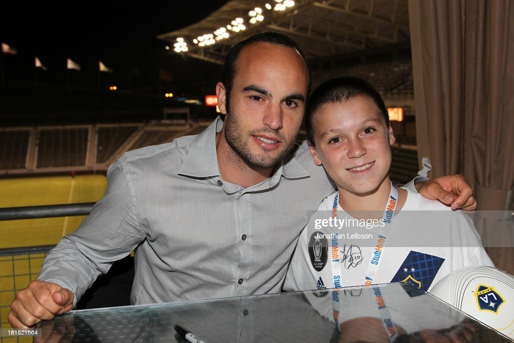 <a gi-track='captionPersonalityLinkClicked' href=/galleries/search?phrase=Landon+Donovan&family=editorial&specificpeople=171601 ng-click='$event.stopPropagation()'>Landon Donovan</a> and guests attend the American Express VIP Game Experience With <a gi-track='captionPersonalityLinkClicked' href=/galleries/search?phrase=Landon+Donovan&family=editorial&specificpeople=171601 ng-click='$event.stopPropagation()'>Landon Donovan</a> at StubHub Center on September 21, 2013 in Los Angeles, California.