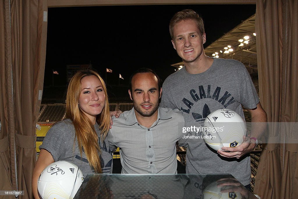 <a gi-track='captionPersonalityLinkClicked' href=/galleries/search?phrase=Landon+Donovan&family=editorial&specificpeople=171601 ng-click='$event.stopPropagation()'>Landon Donovan</a> (C) and guests attend the American Express VIP Game Experience With <a gi-track='captionPersonalityLinkClicked' href=/galleries/search?phrase=Landon+Donovan&family=editorial&specificpeople=171601 ng-click='$event.stopPropagation()'>Landon Donovan</a> at StubHub Center on September 21, 2013 in Los Angeles, California.