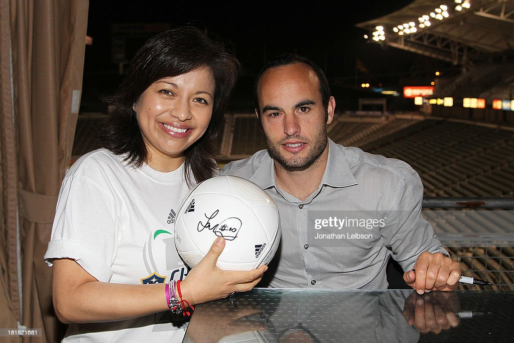 <a gi-track='captionPersonalityLinkClicked' href=/galleries/search?phrase=Landon+Donovan&family=editorial&specificpeople=171601 ng-click='$event.stopPropagation()'>Landon Donovan</a> (R) and Guests attend the American Express VIP Game Experience With <a gi-track='captionPersonalityLinkClicked' href=/galleries/search?phrase=Landon+Donovan&family=editorial&specificpeople=171601 ng-click='$event.stopPropagation()'>Landon Donovan</a> at StubHub Center on September 21, 2013 in Los Angeles, California.