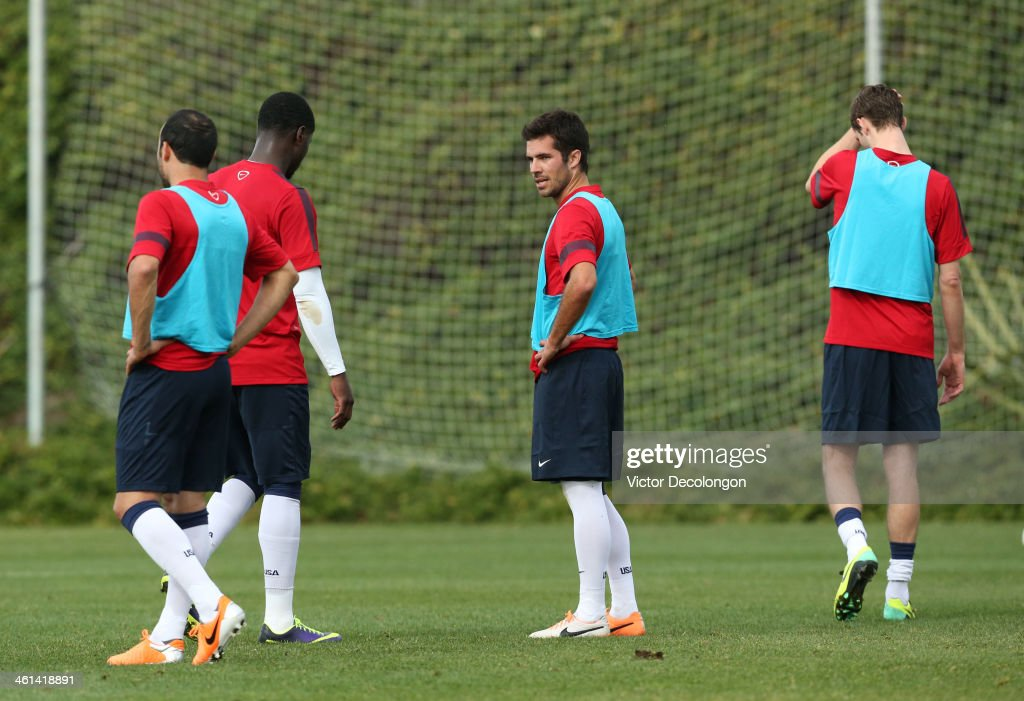 Landon Donovan Eddie Johnson Benny Feilhaber and Clarence Goodson of the US Men's National Soccer team take a break during training at StubHub Center...