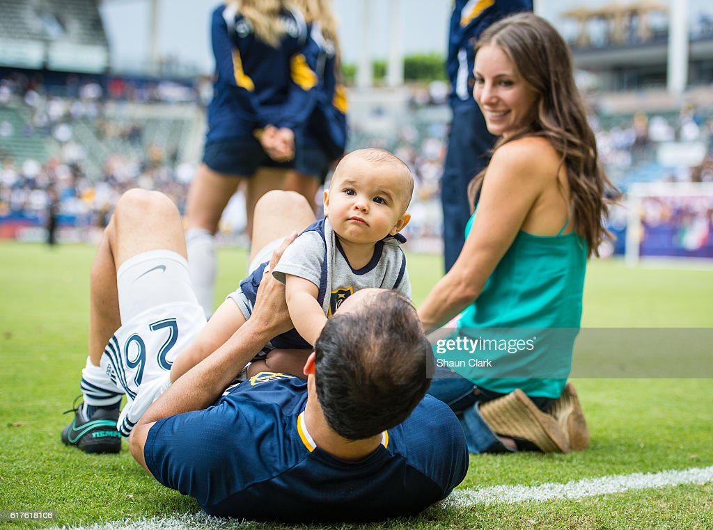 Landon Donovan #26 of Los Angeles Galaxy with his son Talon and his wife Hannah following the Los Angeles Galaxy's MLS match against FC Dallas at the StubHub Center on October 23, 2016 in Carson, California. The match ended 0-0