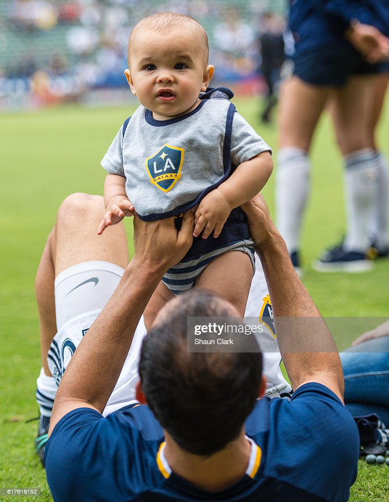 Landon Donovan #26 of Los Angeles Galaxy with his son Talon following the Los Angeles Galaxy's MLS match against FC Dallas at the StubHub Center on October 23, 2016 in Carson, California. The match ended 0-0