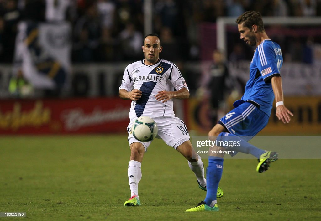 <a gi-track='captionPersonalityLinkClicked' href=/galleries/search?phrase=Landon+Donovan&family=editorial&specificpeople=171601 ng-click='$event.stopPropagation()'>Landon Donovan</a> #10 of the Los Angeles Galaxy and <a gi-track='captionPersonalityLinkClicked' href=/galleries/search?phrase=Clarence+Goodson&family=editorial&specificpeople=2334063 ng-click='$event.stopPropagation()'>Clarence Goodson</a> #44 of the San Jose Earthquakes vie for the ball in the second half of their MLS match at StubHub Center on October 20, 2013 in Los Angeles, California. The Earthquakes and the Galaxy played to a 0-0 draw.
