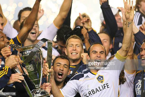 Landon Donovan of the Los Angeles Galaxy and his teammates celebrate with the Philip F Anschutz Trophy after defeating the Houston Dynamo 10 in the...
