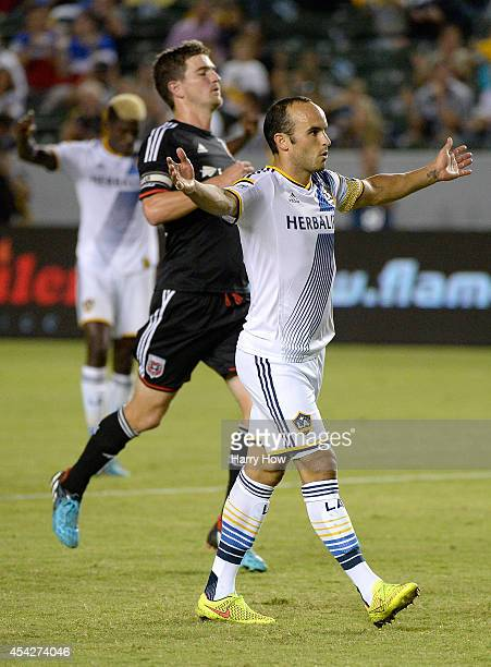 Landon Donovan of the Los Angeles Galaxy celebrates his goal in front of Bobby Boswell of DC United for a 41 lead at StubHub Center on August 27 2014...