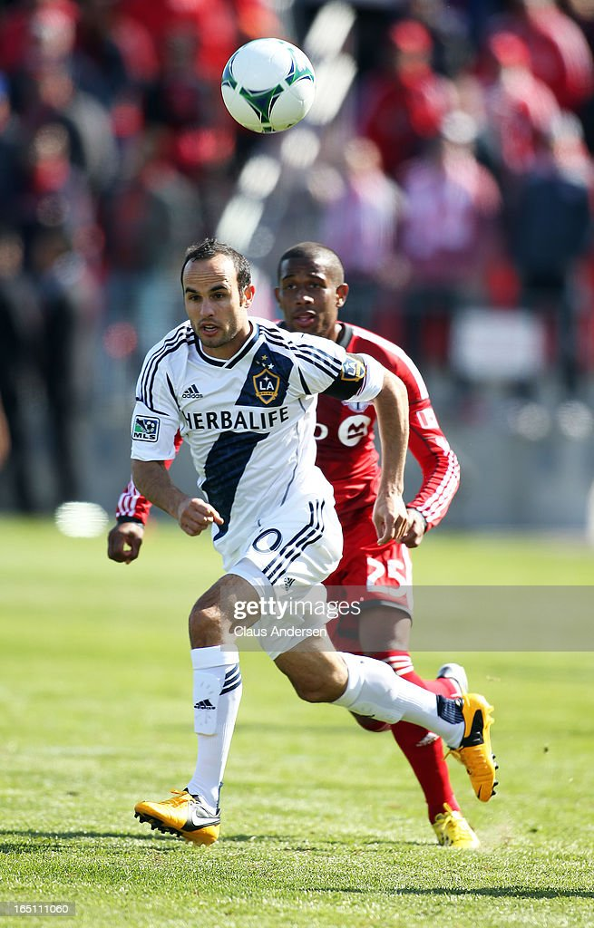 <a gi-track='captionPersonalityLinkClicked' href=/galleries/search?phrase=Landon+Donovan&family=editorial&specificpeople=171601 ng-click='$event.stopPropagation()'>Landon Donovan</a> #10 of the Los Angeles Galaxy chases after the ball with Jeremy Hall #25 of the Toronto FC in an MLS game on March 30, 2013 at BMO Field in Toronto, Ontario, Canada. The Los Angeles Galaxy and Toronto FC played to a 2-2 tie.