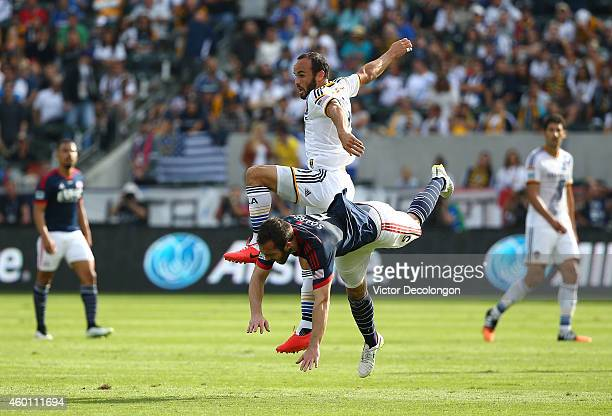 Landon Donovan of the Los Angeles Galaxy clashes with AJ Soares of the New England Revolution in the first half during the 2014 MLS Cup match at...