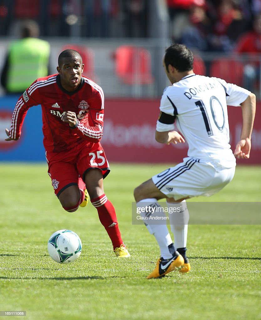 <a gi-track='captionPersonalityLinkClicked' href=/galleries/search?phrase=Landon+Donovan&family=editorial&specificpeople=171601 ng-click='$event.stopPropagation()'>Landon Donovan</a> #10 of the Los Angeles Galaxy defends against Jeremy Hall #25 of the Toronto FC in an MLS game on March 30, 2013 at BMO Field in Toronto, Ontario, Canada. The Los Angeles Galaxy and Toronto FC played to a 2-2 tie.